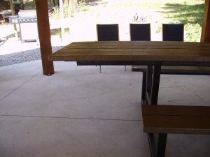 The picnic tables in the pavilion are great for people in manual or power chairs
